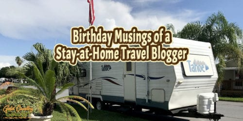 travel trailer parked on street with text overlay: Birthday Musings of a Stay-at-Home Travel Blogger
