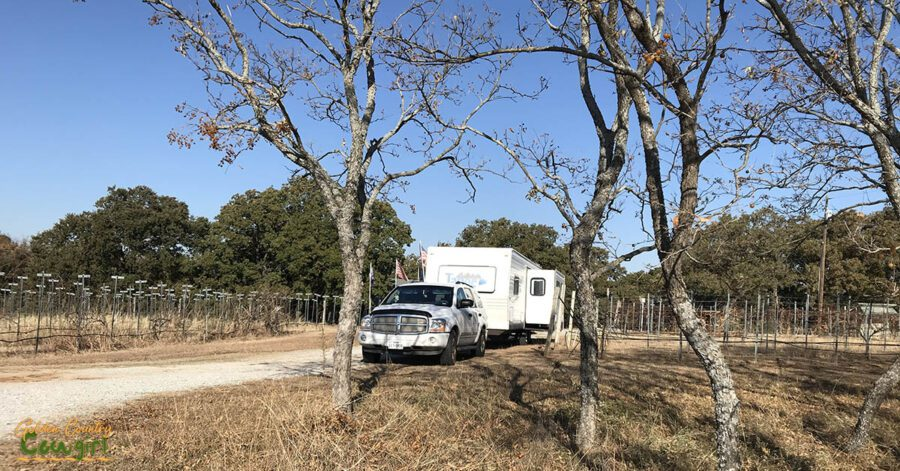 Trailer and tow vehickle parked near vineyard and trees at Brushy Creek which was included in my 2019 fall travel plans