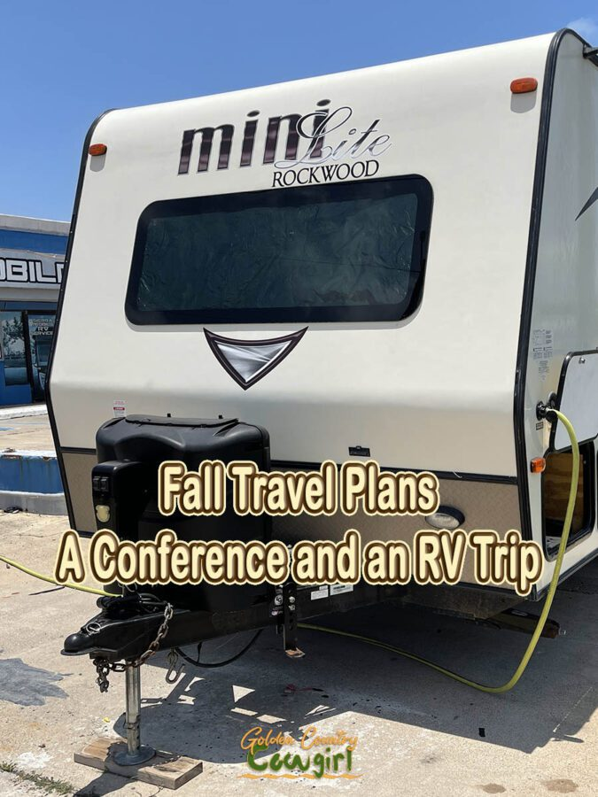 front of a travel trailer with text overlay: Fall Travel Plans A Conference and an RV Trip